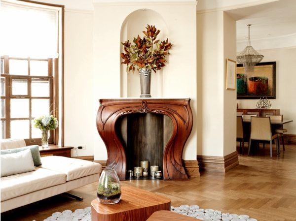 Светлая гостиная с камином в стиле модерн.