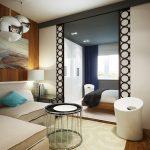 Организация гостиной-спальни при помощи разделения комнаты на две зоны