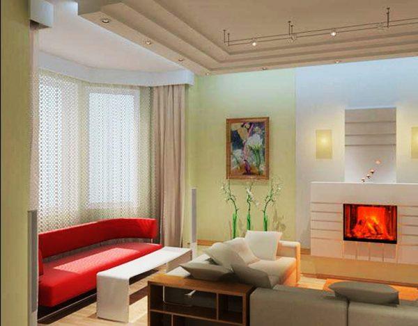Интерьер узкой гостиной с камином