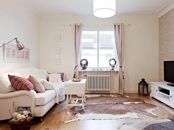 Телевизор в интерьере гостиной в скандинавском стиле