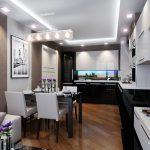 Темная мебель в небольшой кухне гостиной